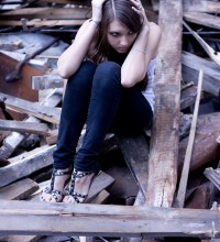 1348272_scared_girl_sits_on_ruins