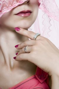891127_a_woman_in_pink_veil_touch_finger_to_the_lips